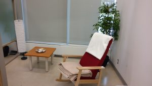 Low Sensory Space containing a chair, table, and private area
